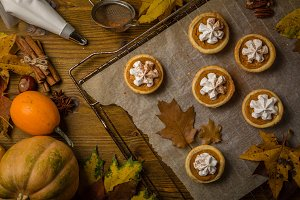 Thanksgiving concept - making mini pumpkin pies
