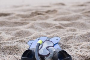 snorkel equipment on a rocky beach