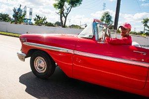 Cubean driver in a red car
