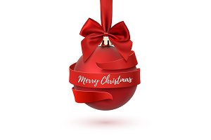 Merry Christmas tree decoration with red bow and ribbon.