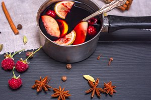 mulled wine in an aluminum ladle