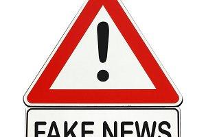 Fake news danger sign isolated over white