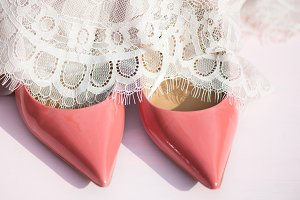 Pink Court Shoes and Lace Dress on Pink Background