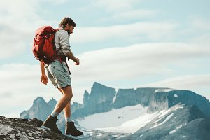 Man with backpack on trek