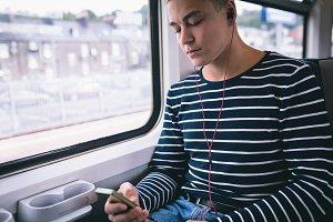 Man listening music on mobile phone
