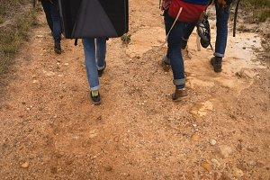 Friends walking in deserted area
