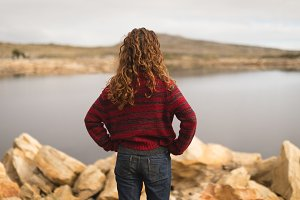 Woman standing near lakeside