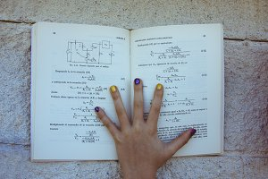hand with notepad school