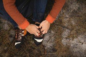 Woman tying shoelace