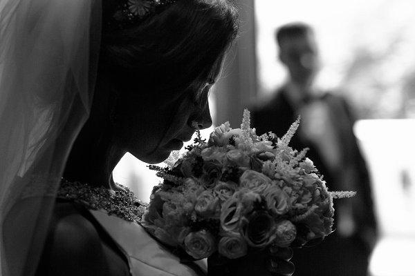Gentle bride holding bouquet
