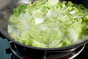 Chinese cabbage chopped in boiled pan