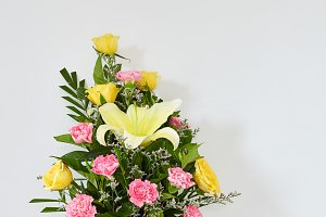 Bouquet yellow Lily flower Rose yellow and carnation pink in a vase
