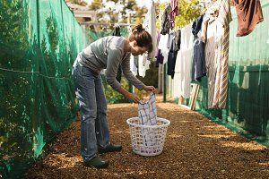 Senior woman hanging laundry on clothes line