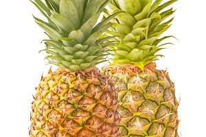 Two pineapple with slices isolated