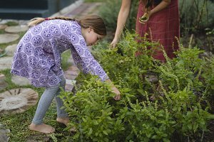 Granddaughter and grandmother gardening in the park