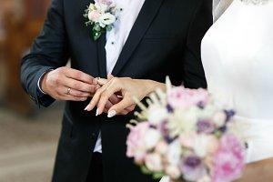 Bride and groom wearing rings