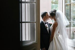 Beautiful bride and groom kissing