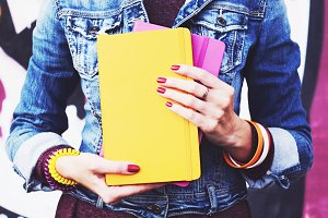 Girl with copybooks