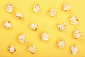 Popcorn on yellow background. Top view. Flat lay pattern