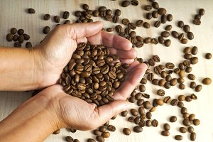 coffee beans  on hands