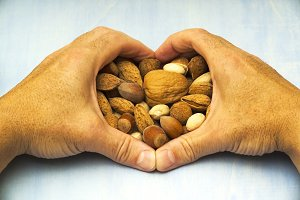 nuts with shaped heart hands