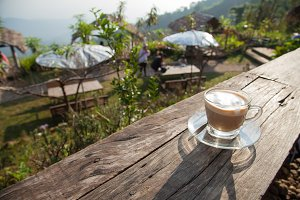 Coffee cup on wooden deck