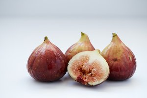 figs fruit with half and quarter isolated on white Background