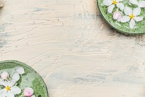 Green water bowls with white blossom