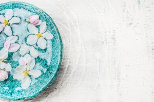 Flowers in turquoise water bowl