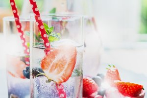 Glasses with berries lemonade