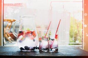 Jug with berries water