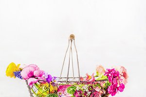 Basket with colorful garden flowers