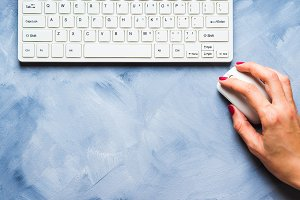 Blue background with woman's hand and keyboard