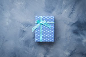 Gift box flat lay on blue