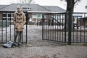 sad girl at schoolyard