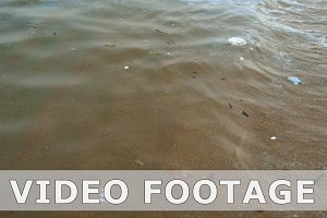 Dirty polluted water at the seashore