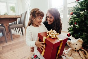 Mother giving Christmas gift