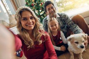 Caucasian family taking photos