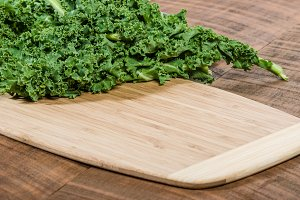 Curly kale on cutting board