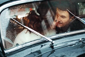 Beautiful couple sitting in the car