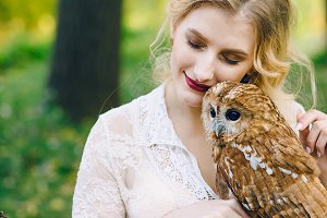 Beautiful girl with owl. The bride with the owl.