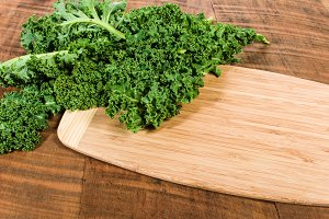Curly kale with bamboo board