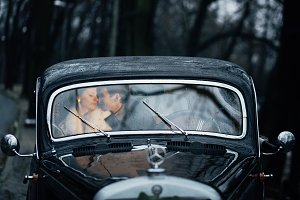 Young couple sitting in the car