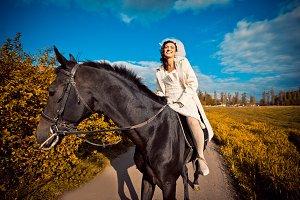 Jazzy bride rides horse around field