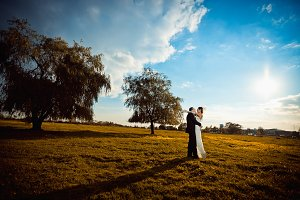 Wedding couple hugging on the field