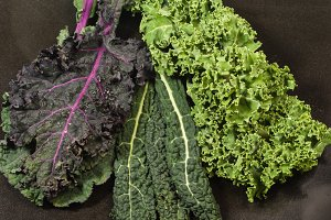 Variety of kale leaves on counter