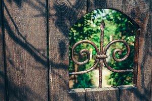 Wooden Door Leading To Garden