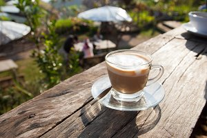 Coffee laid on wooden terrace