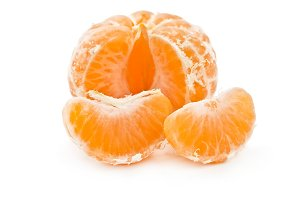 Peeled tangerine with slice