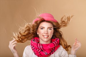 Girl with curly hair in pink hat